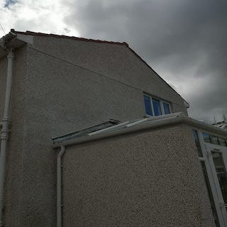 House in Burnside after roughcast