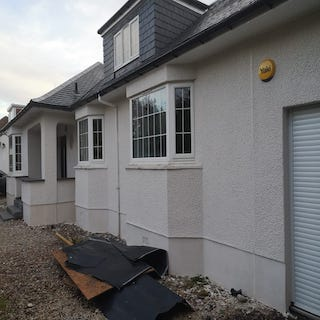 House roughcasted in white chip  Newton Mearns. Glasgow