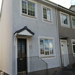 Rear Semi detached house in white chip roughcast