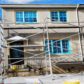 Semi detached house in white chip roughcast
